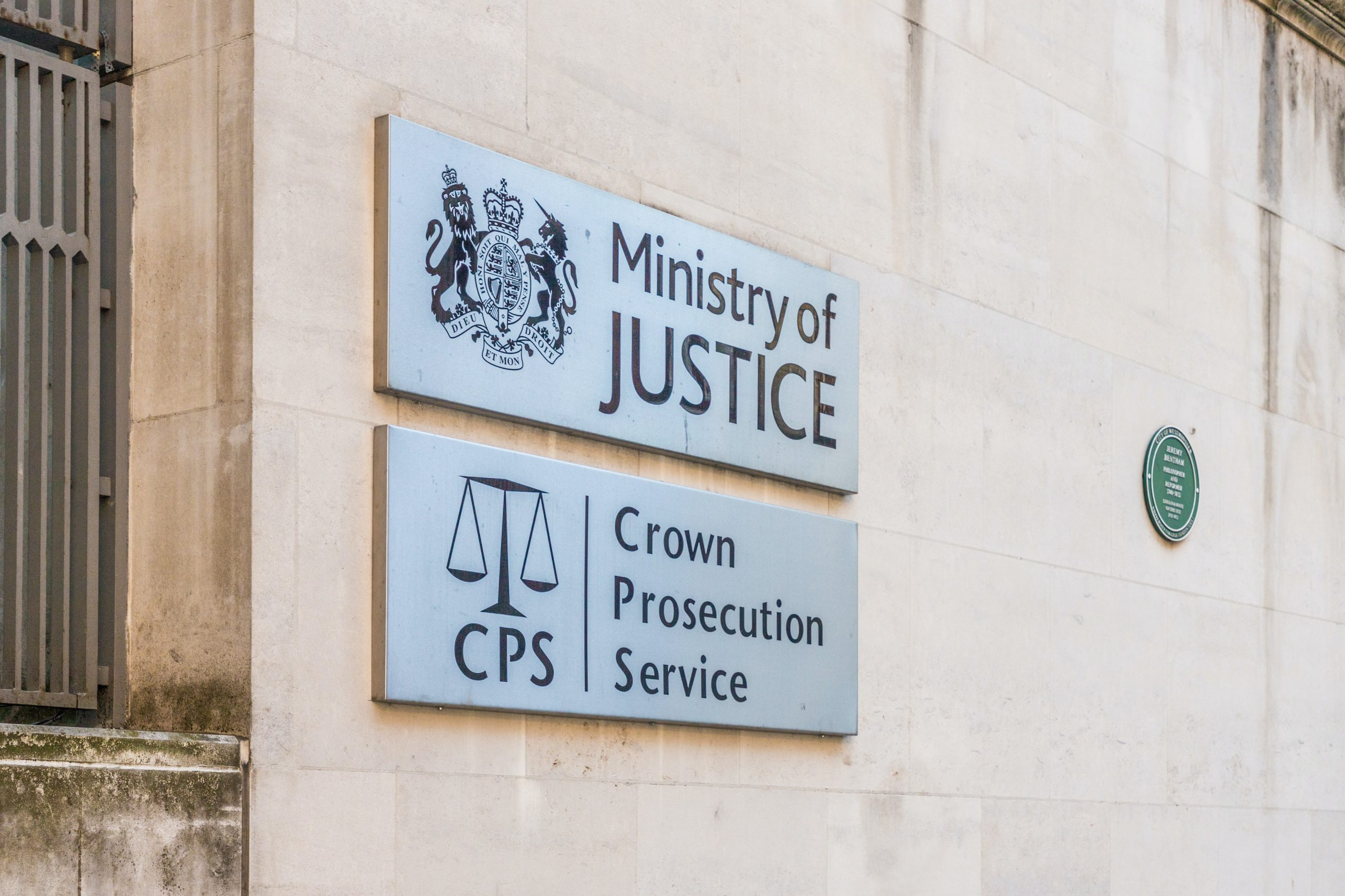 Ministry of Justice sign and Crown Prosecution Service sign on a building