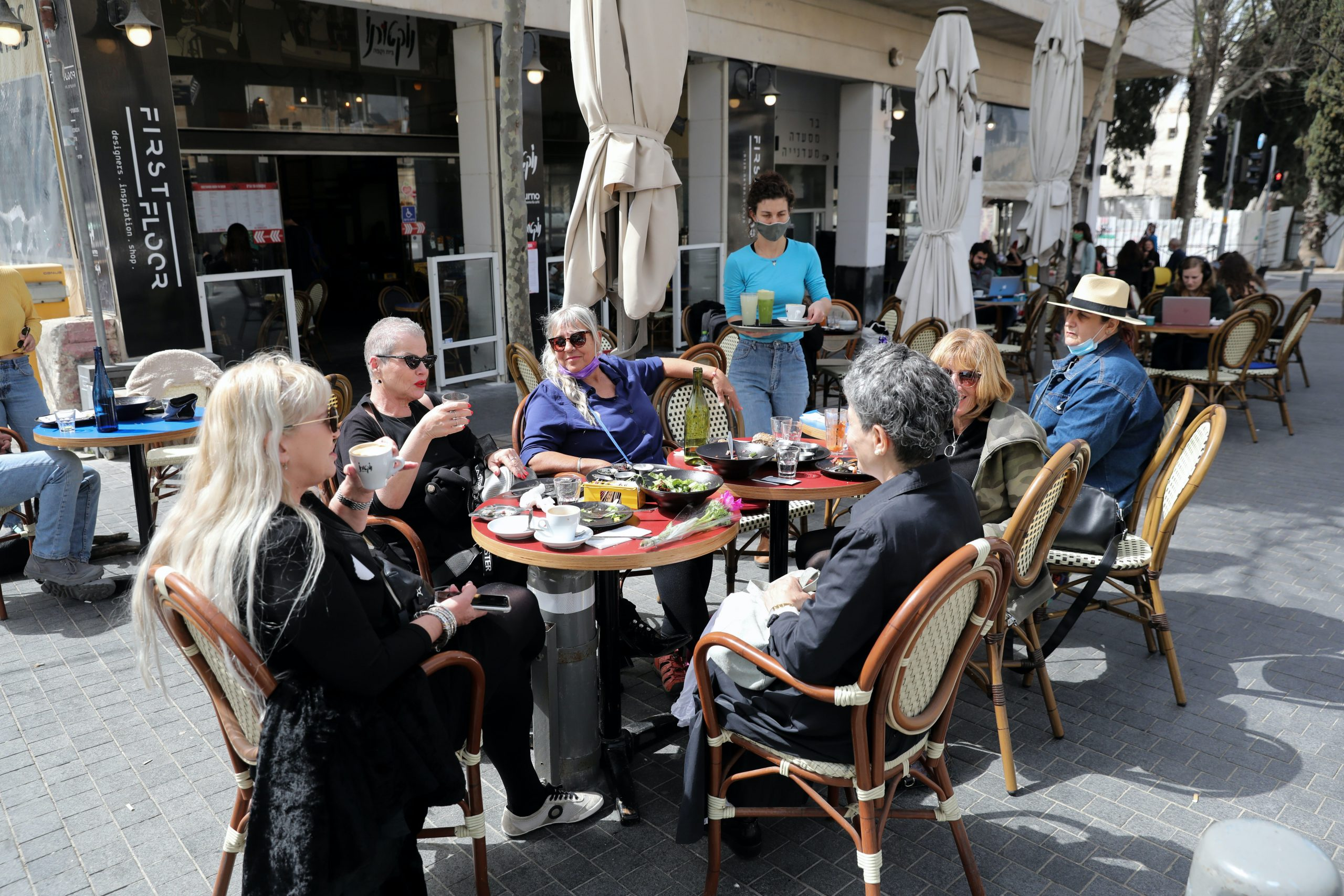 People sit in a re-opened restaurant in downtown Jerusalem.
